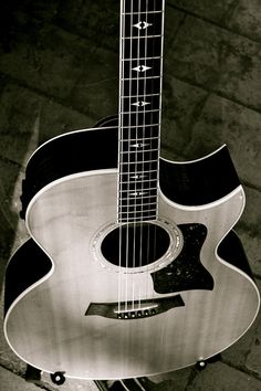 The guitar works by the playing of its six strings with the sound being projected either acoustically or through electrical amplification. It is played by strumming or plucking the strings with the right hand while fretting the strings with the left hand.