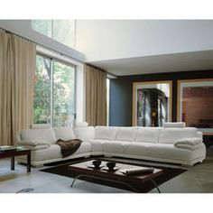 In my art deco white room, one can dream! Chateau d'Ax Versa leather 4 pc Sectional