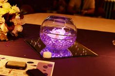 fishbowl centrepieces with gel balls and orchids www.facebook.com/entirelybridal www.entirelybridal.co.uk