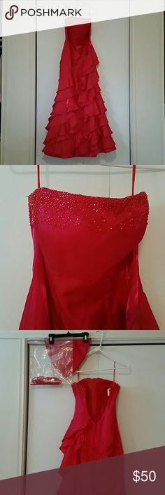"Prom dress This prom dress was only worn once. It is ""Bella Formals by Venus"". It is a strapless size 8 (straps are included as an option). The color is kind of a shimmery red. It has a beaded strip by the top and it is 100% polyester. It has a lace-up back. Also included is a matching shawl with beading. It is in great condition. Bella formals by Venus Dresses Prom"