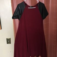 ➕ Plus Size ➕ skater dress with leather sleeves One of my favorite pieces. So comfortable!! It's Burgundy not red ASOS Dresses Midi