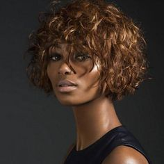 Short chin lrngth cut or style for ethnic, course, curly hair. Great cut to disguise your over-processed or damaged hair.