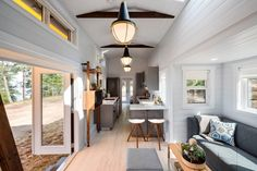 This tiny house on wheels built by Vancouver-based has 2 slide-outs, giving you tons of extra entertaining and bedroom space! Tiny House Movement // Tiny Living // Tiny House Living Room // Tiny Home Kitchen // Tiny House Big Living, Small Tiny House, Best Tiny House, Modern Tiny House, Tiny Houses For Sale, Tiny House Design, Tiny House On Wheels, Little Houses, Tiny Tiny