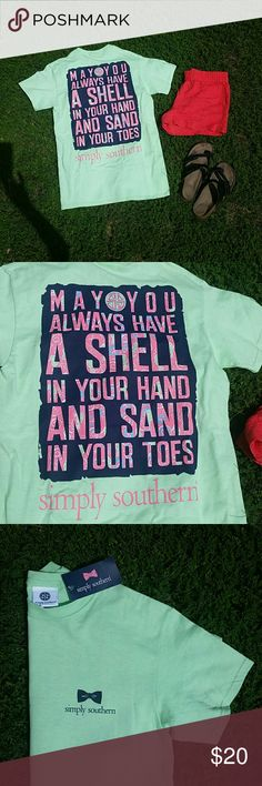 "Simply Southern Beachy Tee Shirt New Simply Southern mint green tshirt with phrase ""may you always have a shell in your hand and sand in your toes"" on back. SS logo on front left chest. Sea horses & starfish on back incorporated into design. Navy blue background with pink, blue and mint green letters. Simply Southern Tops Tees - Short Sleeve"