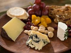 I love the look of this cheese plate with a good variety of cheeses plus some fruit and nuts to bring the flavors together.