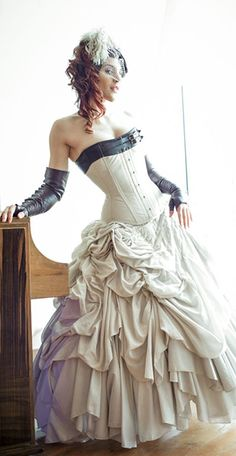 Dollymop Amelia corset by Dark Garden in white cotton canvas with brown leather accent: $650 / Photo: Joel Aron / Model: Dwoira Galilea