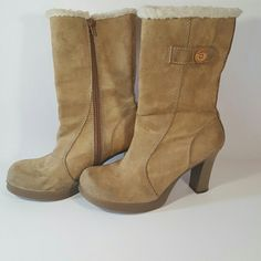 """Cute Candie's heeled suede eskimo boots! Worn a few times; in good condition. Camel colored suede heeled eskimo boots with small platform, by Candie's. Top trim has white insultated lining. Side zipper, stylish contrast stitching, & button detail on outside. Some scuffs & dirty spots (see pics), so they could benefit from a good cleaning; price reflects. Some manufactuer's glue on inside rim of right boot & some discoloration along inside of zipper. Mid-calf rise. Size 8 with a 3.5"""" chunky…"""