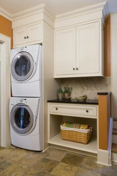 Stacked Washer and Dryer option.  As like standard height cabinets with trim and molding.