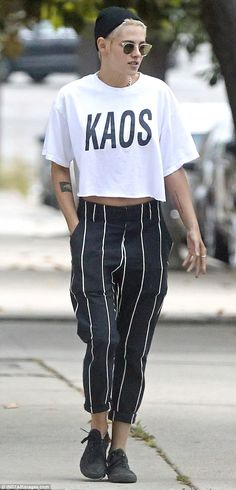 Always stylish: Twilight star Kristen, 27, wore baggy striped pants rolled up at the calf ...