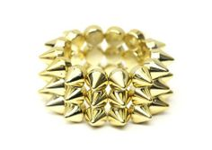Layered Spike Studs Stretch Cuff Bracelet Gold Tone Edgy Punk Bangle Fashion Jewelry Magic Metal. $7.90. Ships from the USA. Makes a perfect gift.. Spikes Bracelet. Three luxurious layers of polished studs give any look an edgy, dangerous vibe.. Search Magic Metal Jewelry for more jewelry styles.. Spike Size: 1/2 inch. Bracelet Width: 3 inches. Stretches to fit.