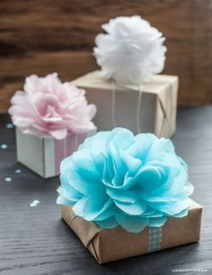 DIY Tissue Paper Poms Craft Tutorial — perfect for gift toppers and more!  HUGE selection of tissue paper including all colors + prints available — See Pin on our Paper Crafts Board.