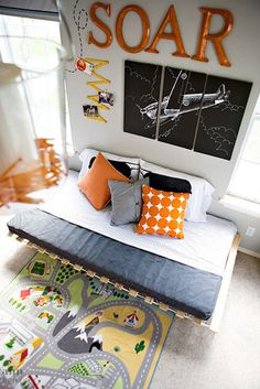 Ryan's airplane room. Love the idea that Cean could make a chalk drawing of an airplane for the wall. Also, the paper airplanes hanging from ceiling and as decals on wall...so creative!