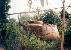 Abandoned Huey in the bush at Cu Chi , Vietnam