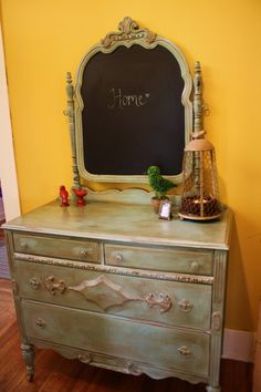 My new foyer piece!  Old dresser with a repurposed mirror (original mirror on other side), but I prefer the chalkboard!