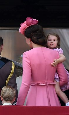 Princess Charlotte takes a last look at the Trooping the Colour celebrations as she is carried back into Buckingham Palace by mum Kate, with brother Prince George at her side.<br><p>Photo: © Rex