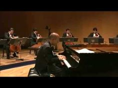 Totoro Theme--Joe Hisaishi plays Totoro Theme with the Orchestra:)  Can't help smiling!!