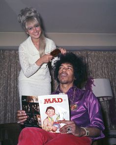 Jimi Hendrix having his hair done while reading 'Mad' Magazine, 1968.