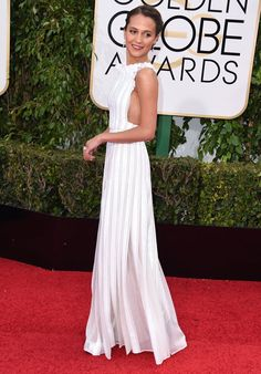 Pin for Later: Alicia Vikander May Be an Actress, But She Looks Like a Freaking Supermodel in These Looks  Alicia's crisp white Louis Vuitton apron dress made plenty of best dressed lists on the night of the Golden Globes.