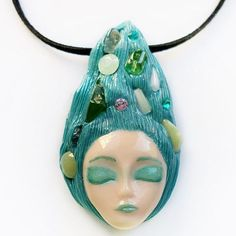 When you're a mermaid turquoise hair is a must.  Are you thinking about summer already? Check out this cute mermaid pendant with semiprecious stones in her hair: titanite crystals lime jade green lace jasper and chalcedony. #mermaid #mermaidvibes #mermaids #mermaidlife #iammermaid #mermaidhair #mermaidjewelry #mermaidpendant #mermaidnecklace #mermaidstuff #mermaidoffduty #turquoise #bluemermaid #semiprecious #semipreciousstones #semipreciousstonesjewelry  #instajewelry #jewelrygram…