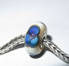 For this bead I used ivory, magic glass and clear. I've lined this bead with sterling silver tubing. This listing is for 1 (one) glass bead. 925 Silver, Sterling Silver, Handmade Beads, Lampwork Beads, Glass Beads, Gemstone Rings, Hearts, Ivory, Gemstones
