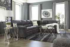 Gleason Contemporary Leather Charcoal Color Sectional Sofas. Two-tone charcoal color is accented with contrasting white piping around the arms. Plush divided back and cushiony seats are elevated with designer stitching. #Sectional #Dark Grey #Gray #Sofa #Loveseat #Couch #Leather #Comfy #Chic – Furnituremaxx