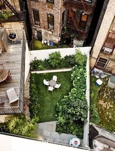 picturesque city homes and gardens. AT HOME West Village backyard  Landscape design by Foras Studio New York City See Jennifer Lopez s NYC Apartment Apartments Rooftop and