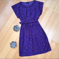 """Blue and gold work office dress, XS S. Very cute work dress by Mossimo. Great details around the neckline. Tie at waist (front or back). Great pattern on material. Tagged an XS but would also fit a small (check measurements). Bust is 18"""", length is 35"""". Dresses Midi"""