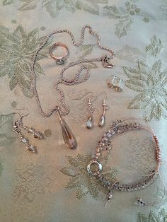 Swarovski golden shadow crystals set with rose gold plated findings and preciosa seed beads.