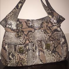 🎉Host Pick🎉Jessica Simpson bag. 🎉7/20 Statement Style Host Pick🎉Jessica Simpson faux snake skin bag. Multiple compartments with beautiful purple lining. Jessica Simpson Bags Totes