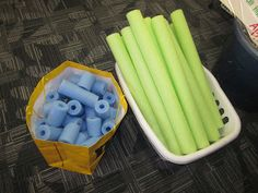 Using pool noodles for tens and ones.  Great way to practice place value!