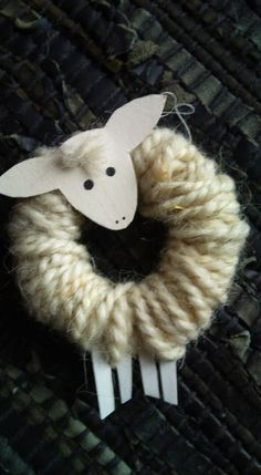 I want to make this #Christmas #ornament!  No directions however looks like light cardboard for head and legs and cut a ring off a toilet paper roll and wrap with wool yarn and you have a #Sheep! Try wrapping body in bright ombre yarn turn out CUTE!