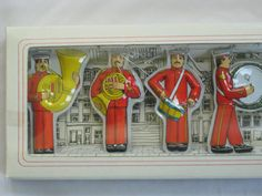 Complete boxed set of eight Christmas ornaments from Dansk, designed by Gunnar Cyren in the 1970's. It's the Swedish Navy Marching band. Copyright information reads: Dansk International Designs, Ltd. Designed by Gunner (sic) Cyren. Made in Taiwan. (ModandMore/Etsy)