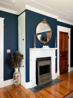 Hague blue bedroom fireplace with white trim. Navy Paint Colors, Blue Wall Colors, Behr Paint Colors, Navy Blue Walls, Blue Painted Walls, Blue Bedroom Colors, Entryway Paint Colors, Entryway Wall, Gray Paint