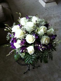 White rose and orchids centerpiece