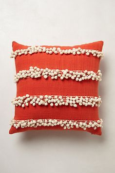 Tassel Trace Pillow by Anthropologie. Pom Pom pillows add texture and fun to a room