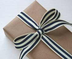 kraft wrap with black and white striped ribbon