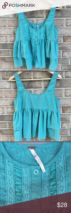 Free People Ruffled Babydoll Tank Free People babydoll Ruffled tank.  Teal blue-green color.  Size small.  Front button with a scoop neck front and back.  Flowy bottom with a second tier of Ruffles.  No stains nor rips.  ❗️Photos show natural light and indoor light.  Indoor light takes on more of a green hue,  more true to Color.  Cute top! Free People Tops Tank Tops