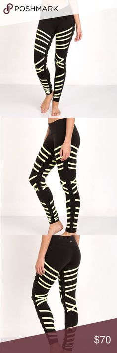 "NWT Alo Yoga GLOW IN THE DARK Airbrush Legging Lightweight, dry-wicking, and anti-microbial performance fabric. From manufacturer's website: ""Tech and fashion collide with our newest printed Airbrush Legging. New glow in the dark engineered matte/shine print is perfectly placed to contour your body while 4-way-stretch technology allows the print to stretch and move with you. No side seams and tummy-flattening waistband give you the same, great airbrush fit."" ALO Yoga Pants Leggings"