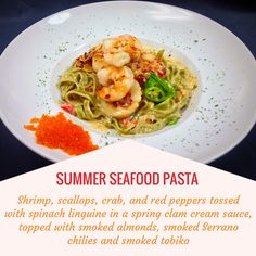 SUMMER SEAFOOD PASTA -- Shrimp, scallops, crab, and red peppers tossed with spinach linguine in a spring clam cream sauce, topped with smoked almonds, smoked Serrano chiles and smoke tobiko