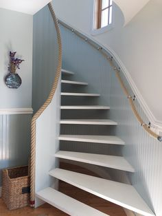 "Rope Stair Railing. R&W Rope's chromed brass stanchions and 1 1/2"" Hempex rope make a perfect choice for this seaside home's handrail.   Stanchions: https://rwrope.com/davey-company-handrail-stanchions-lighter-pattern/  Hempex rope: https://rwrope.com/hempex-synthetic-hemp-rope/"