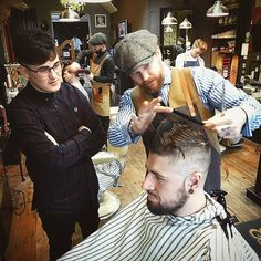 """Going through """"Shape"""" with apprentice """"Coby"""" and how to create it with """"Layering"""" .. Correct tension and correct angles will lead to the correct """"Shape"""" .. Never stop learning .. #StaySharp Guys 💈.. #BarberTown #Barber #barberlife #barberlove #barbershop #barbershopconnect #barbergang #gentshair #menshair #education #learn #teach #skill #schorem #reuzel #uppercutdeluxe #wahl #andis #passion #pinup #tattoo #ink #1 #team #fun"""