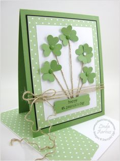 handmade card: Happy St. Patrick's Day from Polka Dots and Paper blog .... cute little shamrocks made of small punched heatrs ... twine stems and triple wrap with a bow ... like the triple mat frame effect with solid green base, thin black and underneath the main panel a wide green layer with polka dots ... great card! ... Stampin'Up!