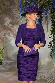 11283 (Condici) Ruched taffeta dress with bolero jacket in Damson. The dress is ruched throughout with beaded floral detailing to the bodice. The skirt is knee length. The matching bolero jacket has 3/4 length sleeves and has lace overlay.