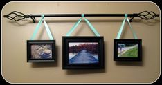 hang a grouping from a curtain rod.  I like this for large wall