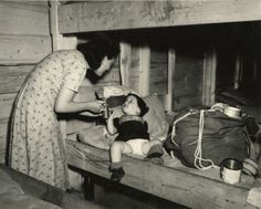 Munich,Germany, 1945    M.R.: A Jewish mother & child stop for food & shelter at the Deutches Camp. This scene was used for background in the film, The Search. It told the story of the upheavel of a Jewish family from Prague. Only the mother & her nine year old son survived Auschwitz and wandered through the UNRRA world in Germany in search of one another. How terribly sad to be a mother at this time & not be able to protect your children from evil. How great her love must have been & her…