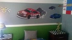 "Race Car Mural Kit Piece 1~Custom race car with yoru child's name on it to make their room special. Additional race cars, oil cans, tire decals, and flags helps to create a speedway track theme which is a great idea for those Nascar fans. Print size is 2' x3'. Custom Race Car with smoke is 35"", Additional race car decals are approx. 8""-14"", tire decal is approx. 10"", Oil can Wall Decals are 6"" & 7"", Flag Trophy Wall Decal is approx. 12"" wide...."