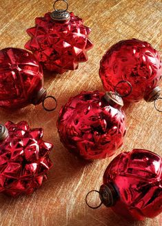 Inspired by vintage designs, Embossed Ornaments enhance any tree-trimming collection with warmth and charm. Traditional hobnail designs and hand-applied finish make each mouth-blown glass ornament feel like a family heirloom.
