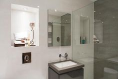 Kohler sanitary ware and Vado Soho taps are among the luxurious bathroom specifications at Overton Court