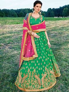 Ravishing green and pink banarasi silk wedding wear designer lehenga choli. Having fabric banarasi silk, santoon and net. This enticing attire is showing some incredible embroidery done with printed, resham embroidery work, patch work, stone work, border work and zardosi work. Comes with matching choli and dupatta. #mydesiwear #onlineshop #womenstyle #womenfashion #silk #weddingwear #ethnicwear #lehengacholi #trendingnow #festiveseason #Diwali #sapnokidiwali #apnokidiwali