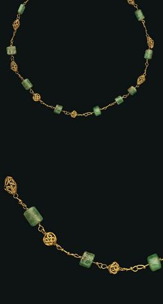 AN EARLY BYZANTINE GOLD AND EMERALD NECKLACE   CIRCA 4TH-5TH CENTURY A.D.   With twelve faceted emerald beads, interspersed with five biconical and two spherical gold openwork beads, with hook-and-loop closure  15 in. (38 cm.) long